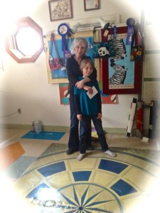 Sandy in her Floorcloth Studio with Grandson Nathaniel